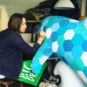 Elli Moody painting her designer dolphin
