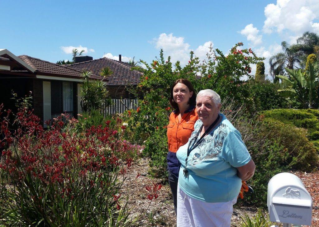 Chorus Gardening - older lady in garden with Chorus gardener