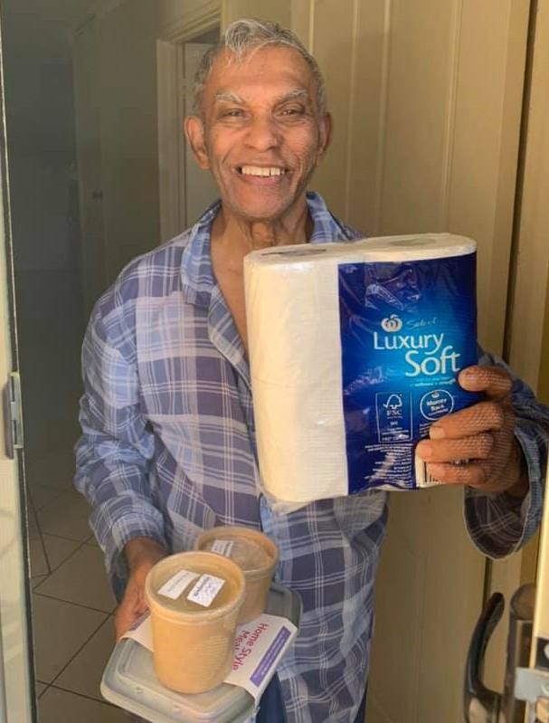 Chorus customer recieving Chorus Kitchen meal and toilet paper