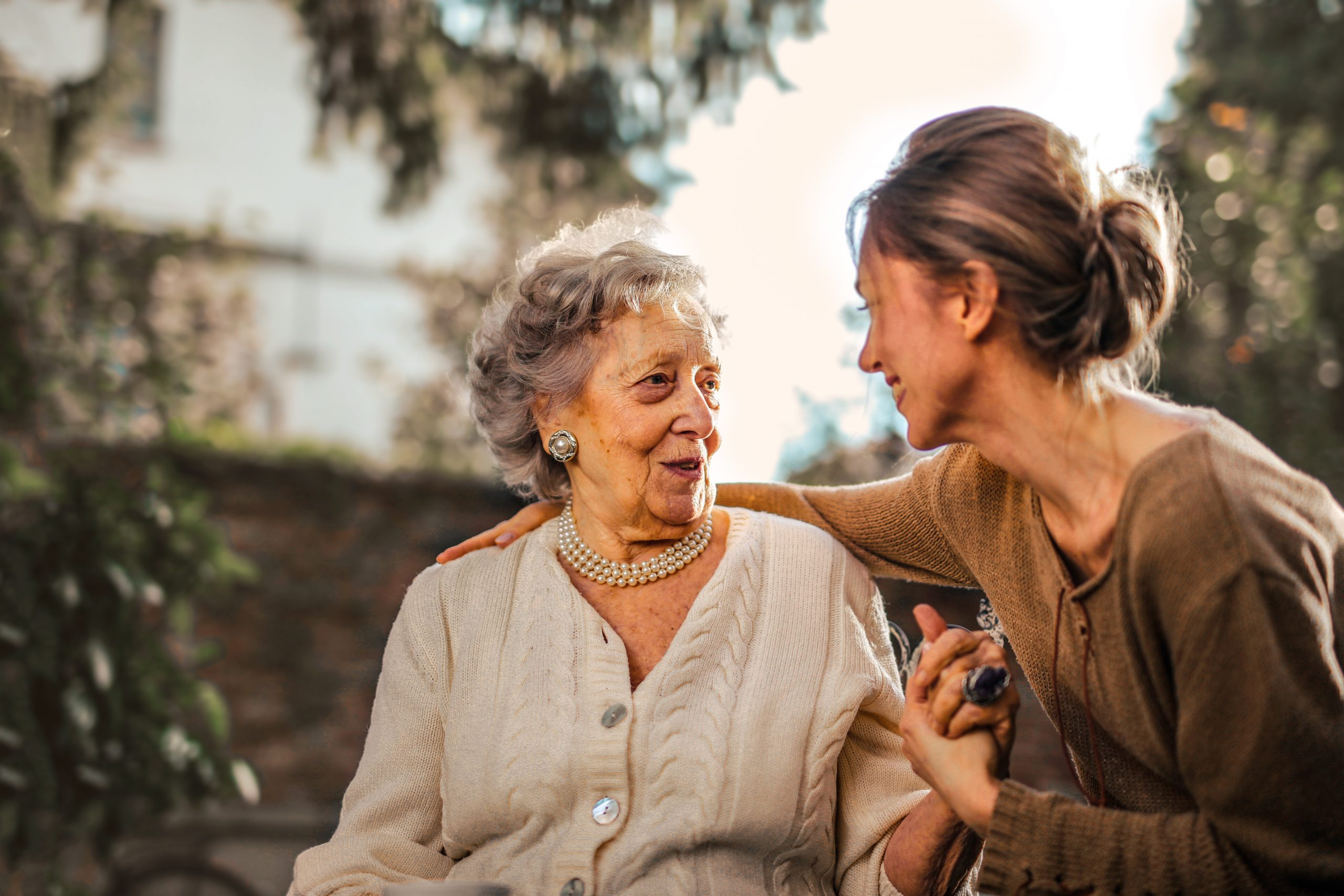 Woman talking to mother about aged care