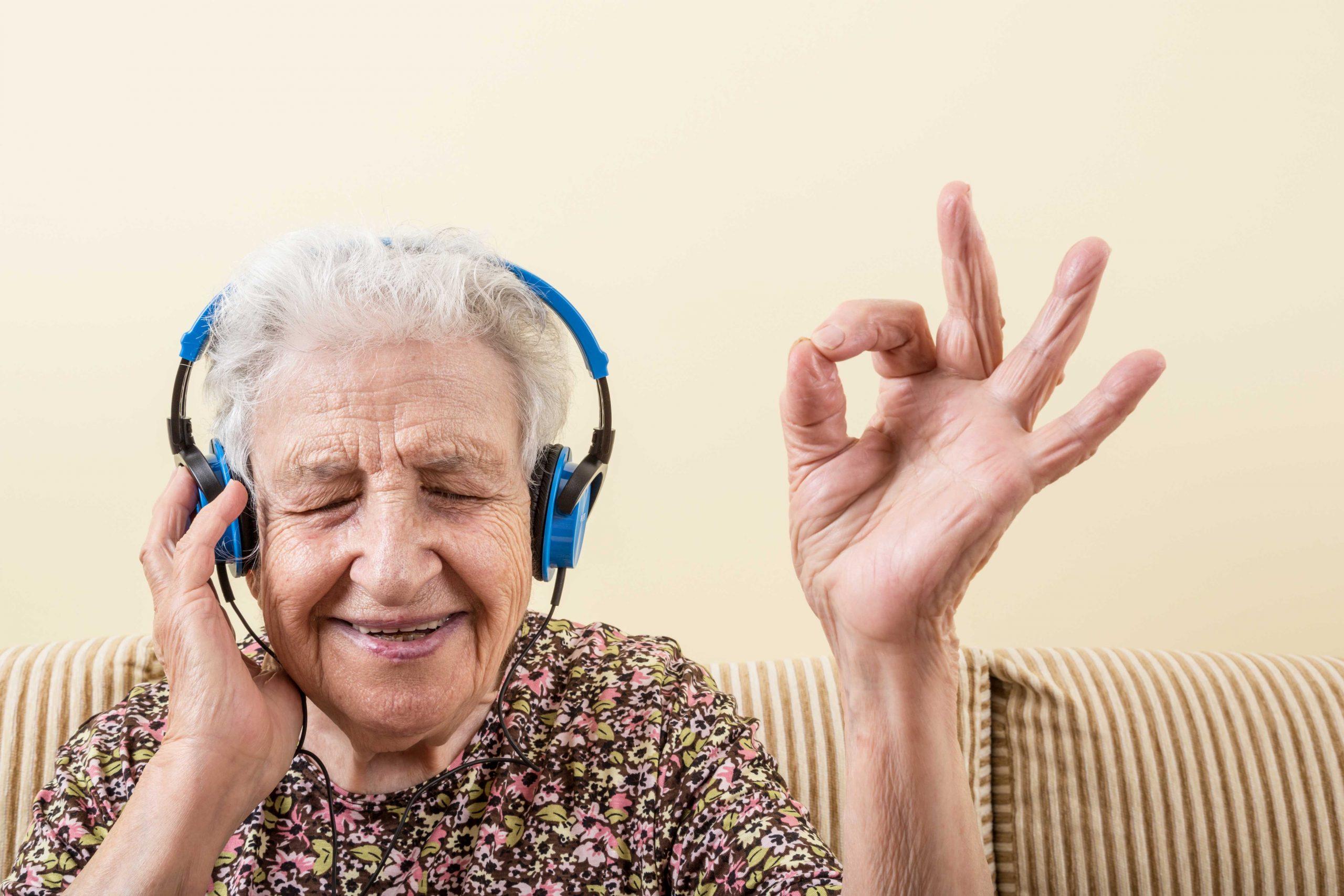 older woman enjoying hearing music